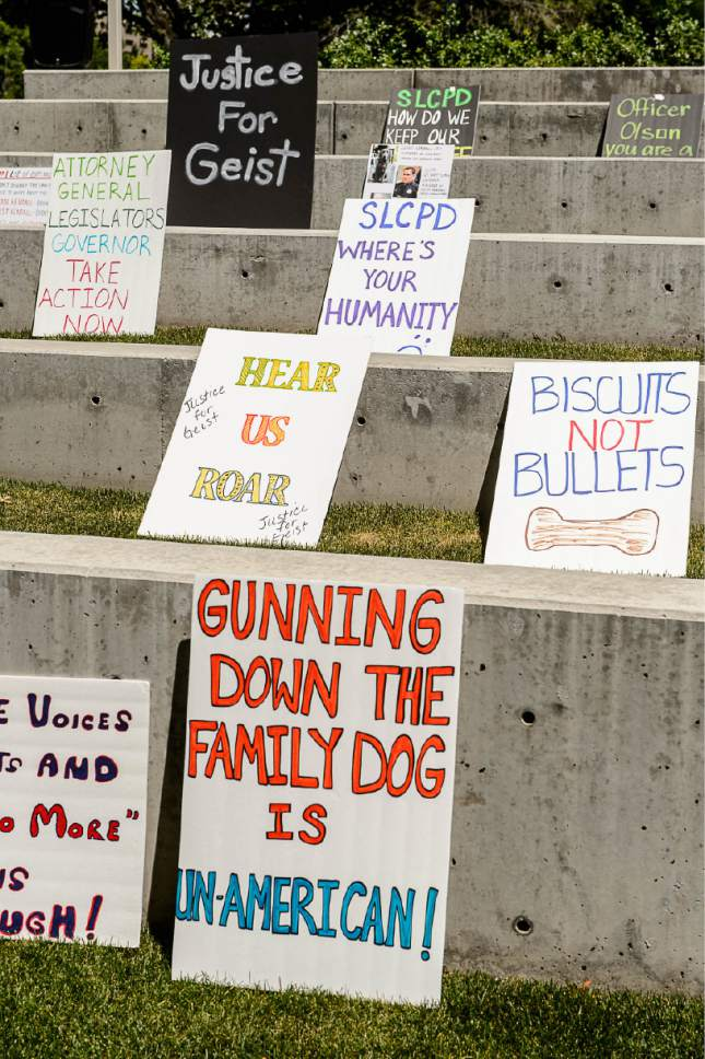 Trent Nelson  |  The Salt Lake Tribune Signs on display as about twenty people and a few pets rally outside Salt Lake City police headquarters , Thursday June 18, 2015, sympathizing with dog owner Sean Kendall and calling for accountability from the department and the officer who fatally shot Kendall's Weimaraner one year ago.