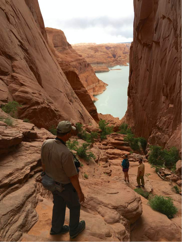 |  courtesy of National Park Service  Steve Henry, a Nation Park Service backcounty ranger, visits Hole in the Rock, the famous trail cut by Mormon pioneer expedition to reach San Juan County in 1880, along with anthropologist Katie Brown, and Erik Stanfield, a cultural  resource specialist for Glen Canyon National Recreation Area. Utah officials are interested in developing a new state park in part of Garfield County to commemorate the San Juan Expedition and enable bigger groups to visit.