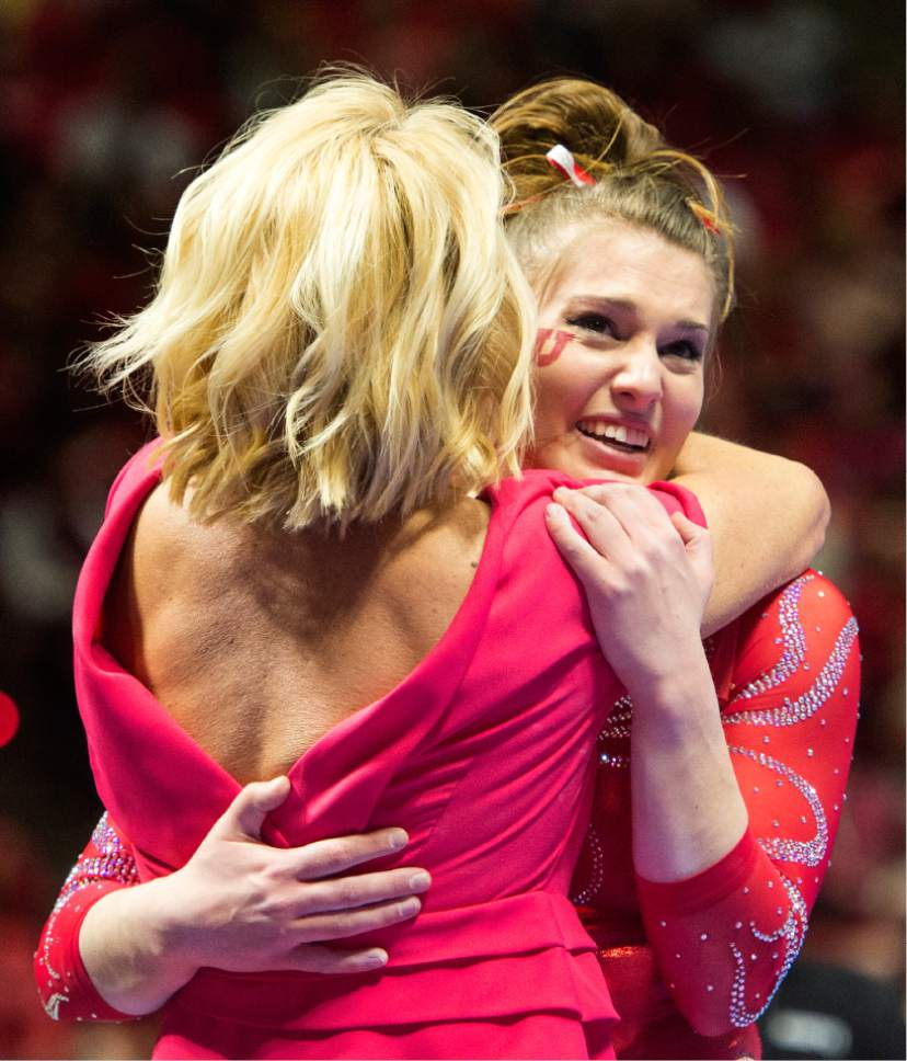 Rick Egan  |  The Salt Lake Tribune  Baely Rowe gets a hug from coach Megan Marsden after her performance on the beam for the Utes, in gymnastics action, Utah vs UCLA, at the Huntsman Center, Saturday, February 18, 2017.