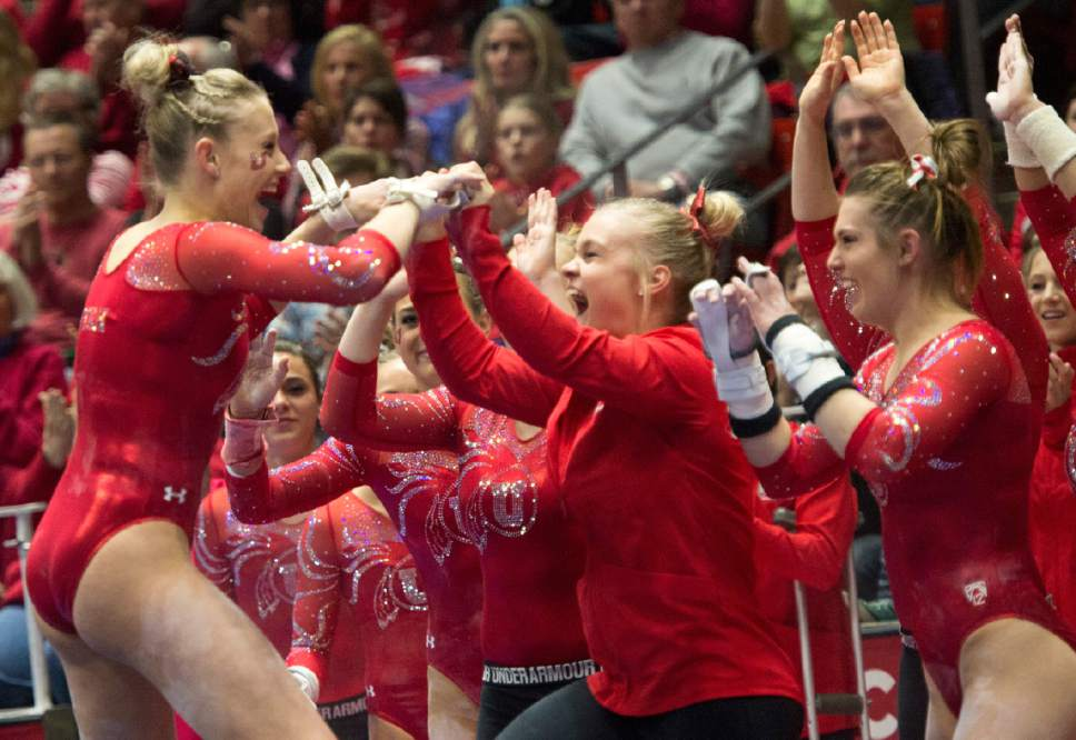Rick Egan  |  The Salt Lake Tribune  MaKenna Merrell is congratulated by her teammates after her bars routine, for the Utes, in gymnastics action, Utah vs UCLA, at the Huntsman Center, Saturday, February 18, 2017.