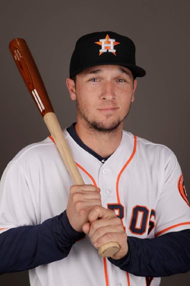 FILE - In this Feb. 19, 2017, file photo, Houston Astros' Alex Bregman poses for a photo before a spring training baseball workout in West Palm Beach, Fla. Bregman had a slow start to his major league career last season before getting going late in the year. The Astros need him to build on his strong finish this season with the 22-year-old expected to be their everyday third baseman.  (AP Photo/David J. Phillip, File)