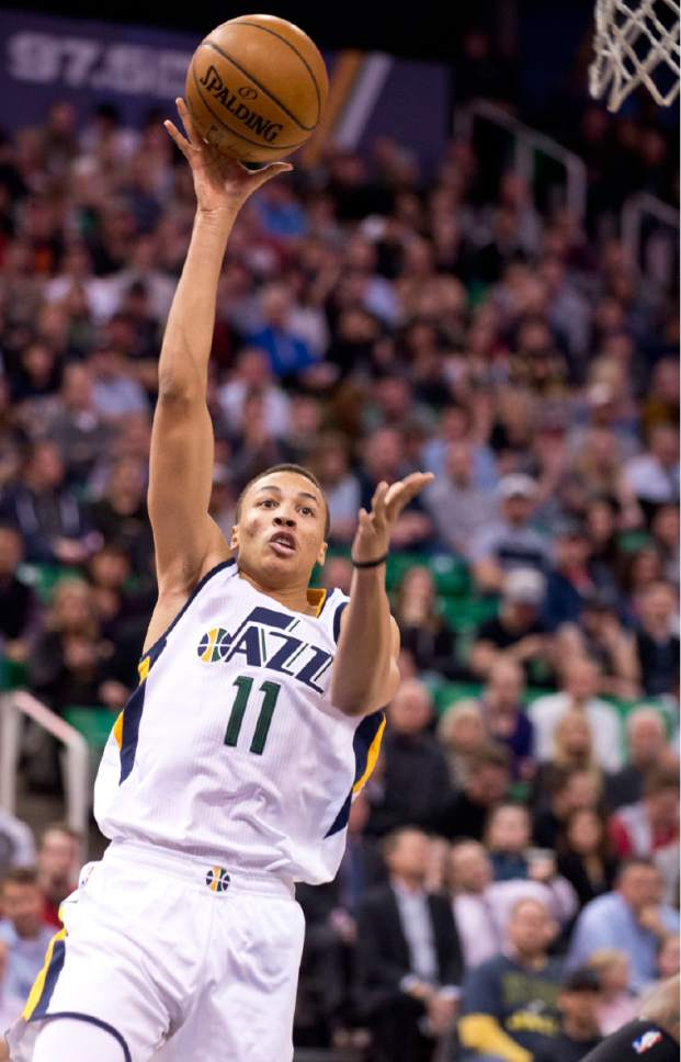 Lennie Mahler  |  The Salt Lake Tribune  Dante Exum shoots the ball in the first half of a basketball game between the Utah Jazz and the LA Clippers at Vivint Smart Home Arena, Monday, Feb. 13, 2017.