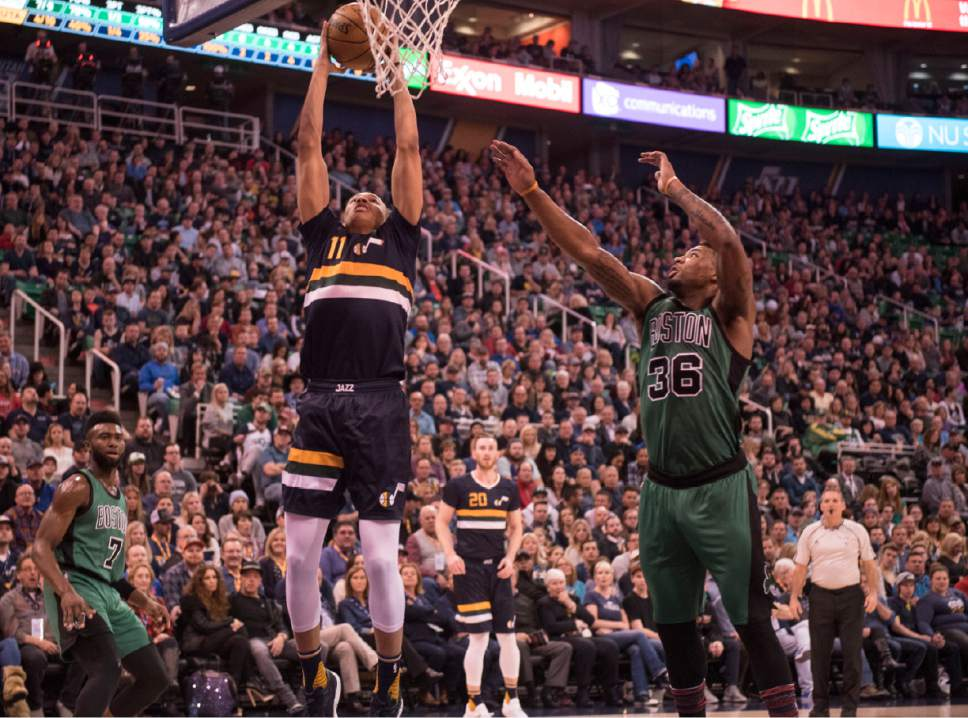 Lennie Mahler  |  The Salt Lake Tribune  Dante Exum dunks the ball over Boston's Marcus Smart in the first half of a game between the Utah Jazz and the Boston Celtics on Saturday, Feb. 11, 2017.