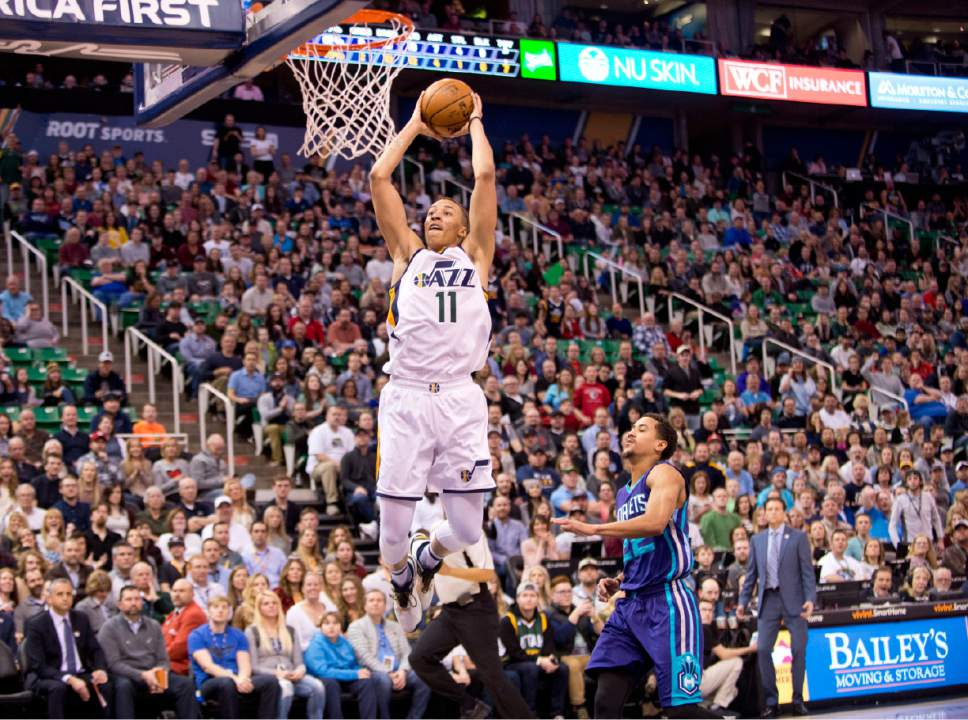 Lennie Mahler  |  The Salt Lake Tribune  Dante Exum dunks as he is followed by Charlotte's Brian Roberts in a game at Vivint Smart Home Arena on Saturday, Feb. 4, 2017.