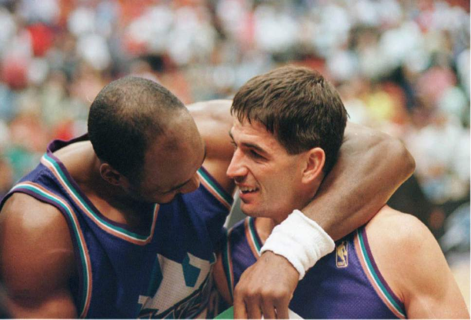 Tribune file photo  Karl Malone and John Stockton share a moment on the court in this 1997 photo.
