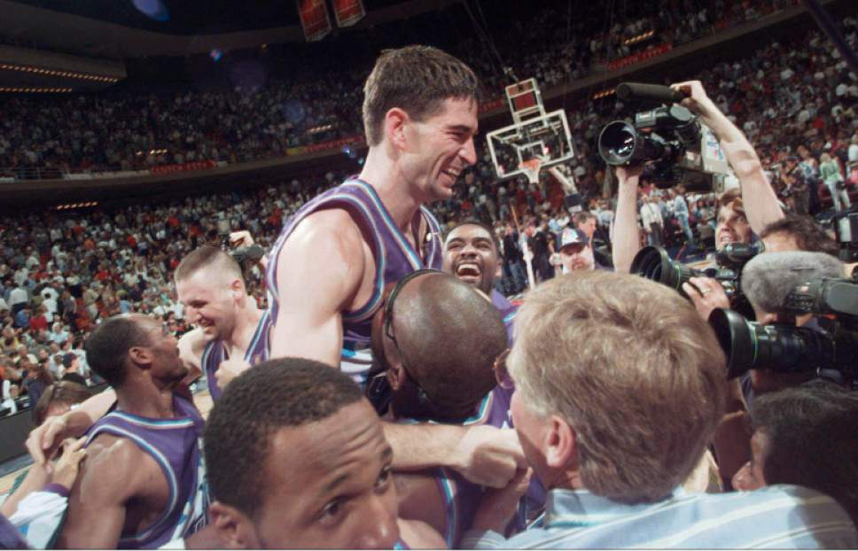 Pat Sullivan  |  Associated Press  Utah Jazz's John Stockton is lifted on the shoulders of his teammates after sinking a three-point shot at the buzzer to beat the Houston Rockets 103-100 in Game 6 of the Western Conference Finals Thursday, May 29, 1997, in Houston. The Jazz advanced to play the Chicago Bulls in The NBA Finals.
