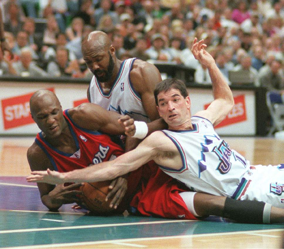 Karl Malone and John Stockton battle Lamar Odom of the Los Angeles Clippers for a loose ball during a 2001 game.  Steve Griffin/Tribune file photo