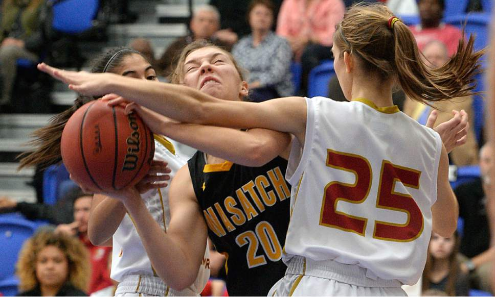 Al Hartmann     The Salt Lake Tribune Judge High School's Cicely Foley blocks Wasatch High School's Hannah Johnston's path in first round action in the 2017 4A Girls' State Basketball Championships game Tuesday Feb. 21.  Judge went on to edge Wasatch High School 35-32 to enter the quarterfinals.