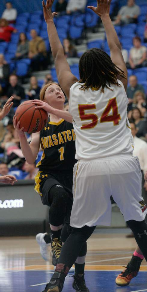 Al Hartmann     The Salt Lake Tribune Wasatch High School's 5-1 guard Faith Fitzgerald is humbled by the size of Judge center Vanessa Austin in first round action in the 2017 4A Girls' State Basketball Championships game Tuesday Feb. 21.  Judge went on to edge Wasatch High School 35-32 to enter the quarterfinals.