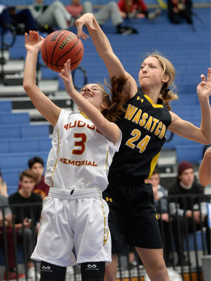Al Hartmann     The Salt Lake Tribune Wasatch High School's Taylor Hardman swats ball away from Judge's Haley Auer in first round action in the 2017 4A Girls' State Basketball Championships game Tuesday Feb. 21.  Judge went on to edge Wasatch High School 35-32 to enter the quarterfinals.