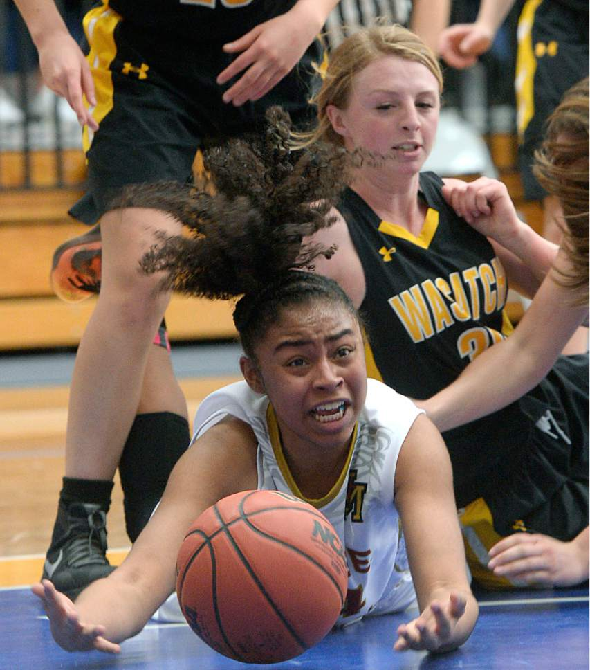 Al Hartmann     The Salt Lake Tribune Judge High School's Miyalla Tarver scrambles for the ball with Wasatch's Kenzie Mcbride in first round action in the 2017 4A Girls' State Basketball Championships game Tuesday Feb. 21.  Judge went on to edge Wasatch High School 35-32 to enter the quarterfinals.