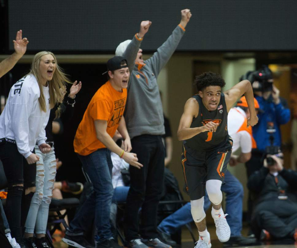 Oregon State fans react after Stephen Thompson Jr. (1) made a shot during the second half of an NCAA college basketball game in Corvallis, Ore., Sunday, Feb. 19, 2017. Oregon State won 68-67 for their first win in a Pac-12 Conference game this year. (AP Photo/Timothy J. Gonzalez)
