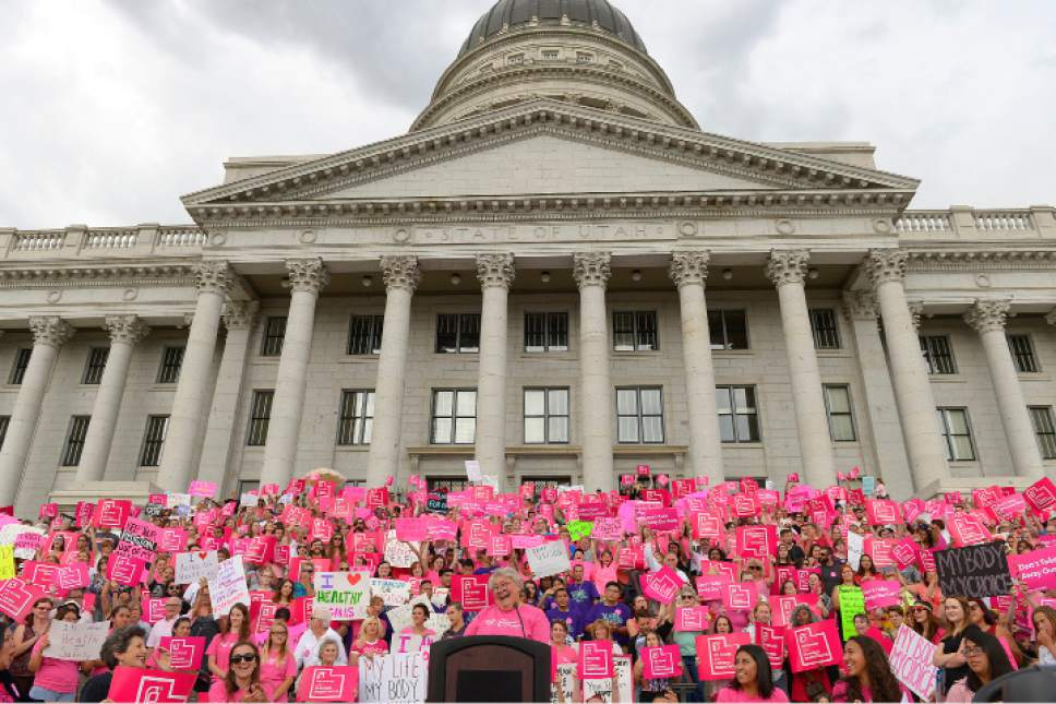 FILE - This Aug. 25, 2015, file photo, Karrie Galloway, CEO of Planned Parenthood Action Council, laughs as the roar of the crowd drowns out her speech at the state Capitol in Salt Lake City. Galloway says her doctors are trying to comply with the law, but there is no clear guidance in the law or from state officials on how to do so. (Leah Hogsten/The Salt Lake Tribune via AP, File)