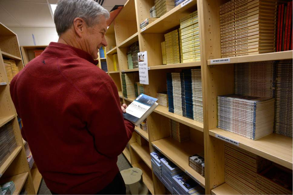 Scott Sommerdorf      The Salt Lake Tribune   University of Utah athletic director Chris Hill looks at book he remembers from his time at Granger High when he spent four years there as a math teacher and basketball coach. Hill came back to the school for an interview, Thursday, February 9, 2017.