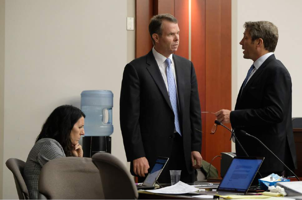 Francisco Kjolseth | The Salt Lake Tribune Former Utah Attorney General John Swallow, center, speaks with his defense attorney Scott C. Williams on day 10 of his public-corruption trial in Salt Lake City, Wednesday, February 22, 2017.