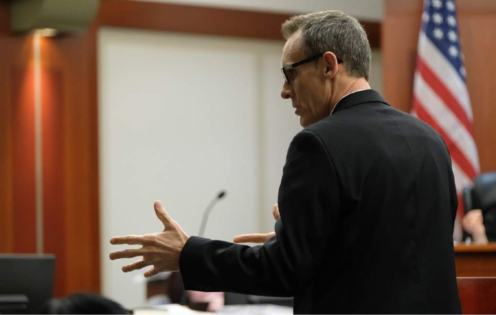 Francisco Kjolseth | The Salt Lake Tribune Assistant Salt Lake County District Attorney Fred Burmester speaks with defense during the John Swallow public-corruption trial in Salt Lake City, Wednesday, February 22, 2017.