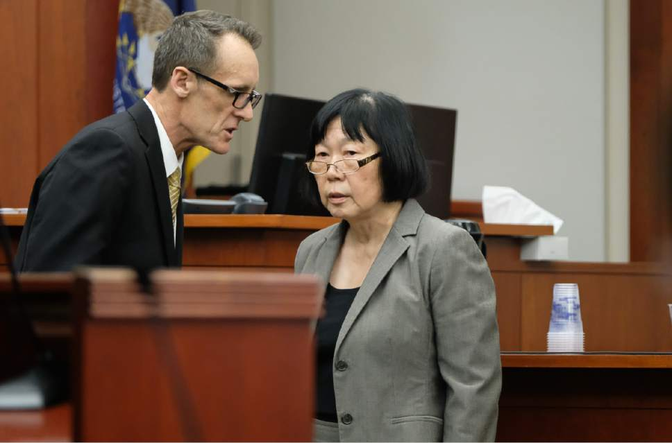 Francisco Kjolseth | The Salt Lake Tribune Assistant Salt Lake County District Attorney Fred Burmester speaks with prosecutor Chou Chou Collins on day 10 of the John Swallow public-corruption trial in Salt Lake City, Wednesday, February 22, 2017.