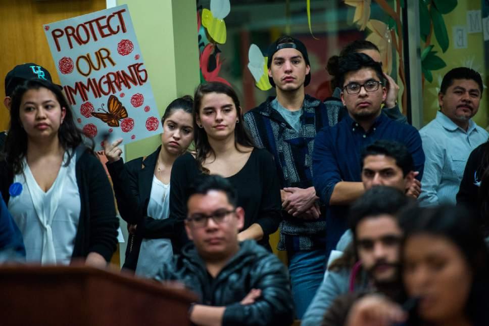 Chris Detrick     The Salt Lake Tribune University of Utah student Chelsea Estrella holds a sign during a Salt Lake City School Board meeting at Glendale Middle School Tuesday February 21, 2017.