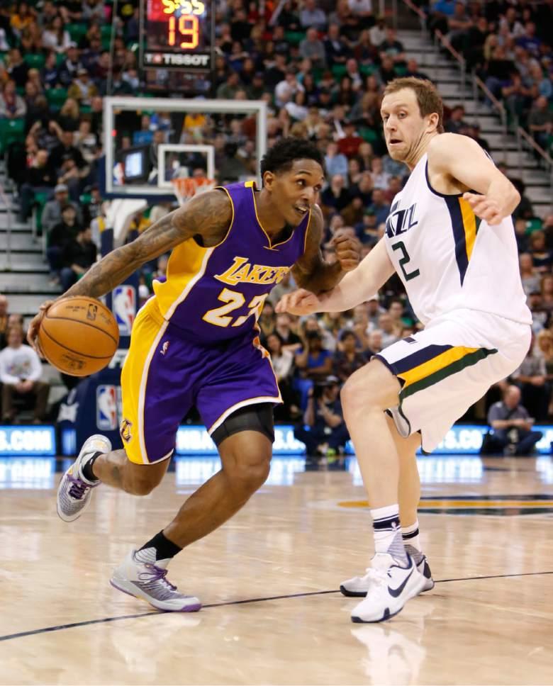 Los Angeles Lakers' Lou Williams (23) drives the basket as Utah Jazz's Joe Ingles (2) defends in the first half of an NBA basketball game Thursday, Jan. 26, 2017, in Salt Lake City. (AP Photo/Kim Raff)