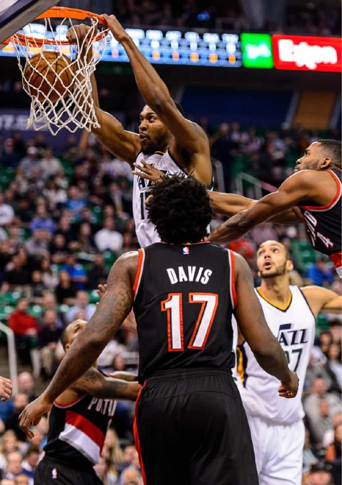 Trent Nelson  |  The Salt Lake Tribune Utah Jazz forward Derrick Favors (15) dunks the ball as the Utah Jazz host the Portland Trailblazers, NBA basketball in Salt Lake City, Wednesday February 15, 2017.