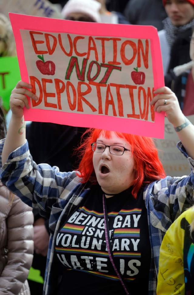 Demonstrators hold a rally Monday, Feb. 20, 2017, in Salt Lake City. The rally is one of several Not My Presidents Day protests planned across the country to mark the Presidents Day holiday. Protesters are criticizing President Donald Trump's immigration policies, among other things. (AP Photo/Rick Bowmer)
