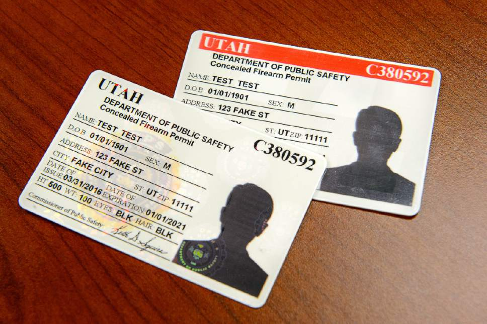 Trent Nelson  |  The Salt Lake Tribune The Utah Department of Public Safety announed changes to Utah Concealed Firearms Permits Tuesday May 10, 2016. The new card, at left, does not have the bright red line at the top of each card, among other changes.