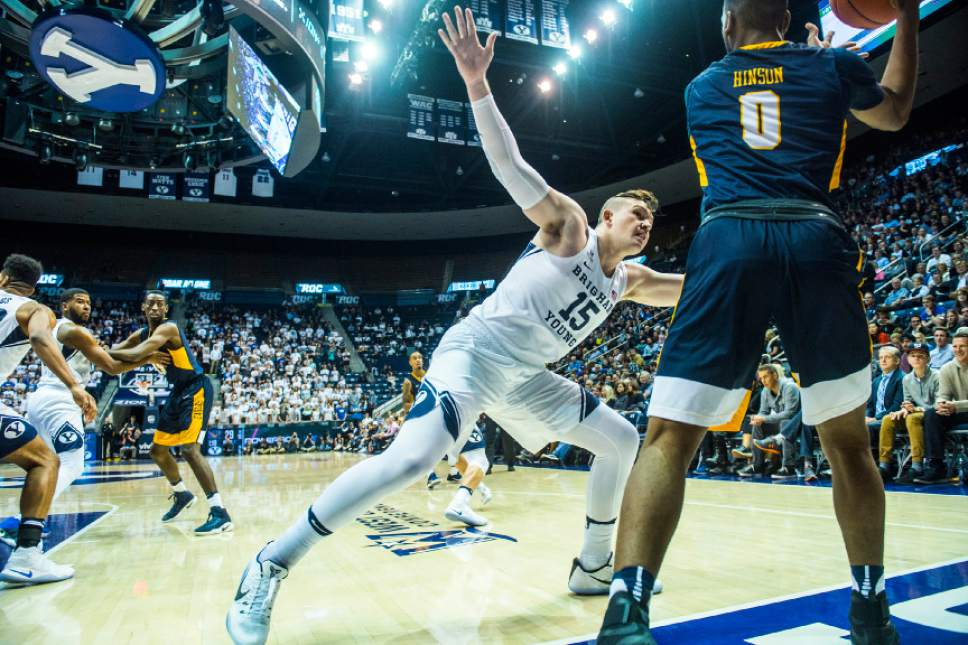 Chris Detrick  |  The Salt Lake Tribune Brigham Young Cougars forward Payton Dastrup (15) guards Coppin State Eagles guard Rasool Hinson (0) during the game at the Marriott Center Thursday November 17, 2016.