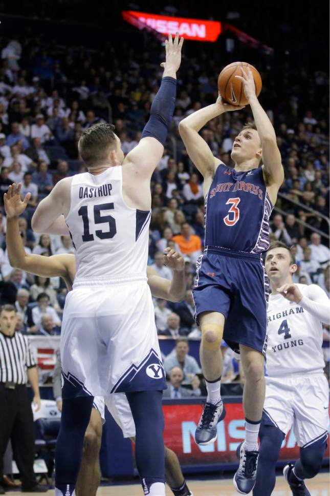 St. Mary's guard Emmett Naar (3) shoots as BYU forward Payton Dastrup (15) defends during the first half of an NCAA college basketball game Saturday, Feb. 18, 2017, in Provo, Utah. (AP Photo/Rick Bowmer)