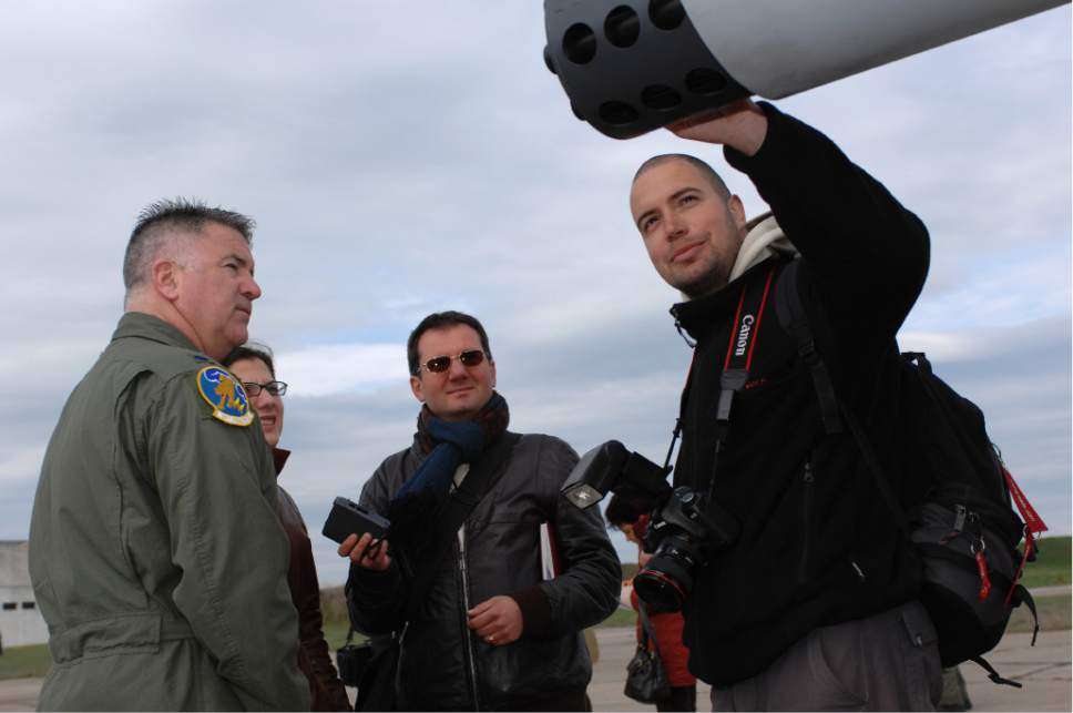 "Master Sgt. Bill Gomez  |  U.S. Air Force  BEZMER AIR BASE, Bulgaria – Lt. Col. Timothy Hogan, 81st Fighter Squadron commander answers questions regarding A-10's capabilities for Bulgarian reporters during the ""Reunion April 2009"" media day April 15, 2009."