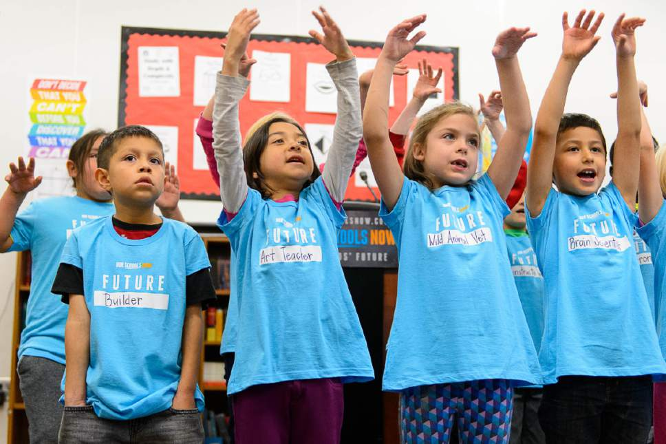 Trent Nelson  |   Tribune file photo Second graders at Washington Elementary School sing a song at a press conference announcing the launch of a ballot initiative for an income tax increase to fund schools during the 2018 election, Tuesday November 29, 2016.