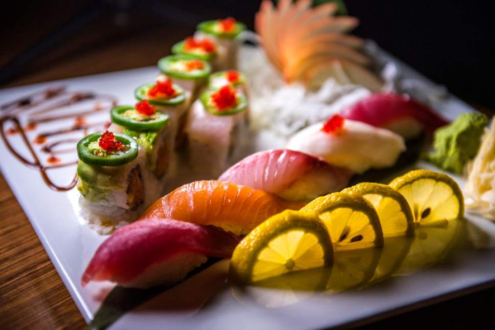 Chris Detrick  |  The Salt Lake Tribune The Mind Eraser roll with spicy crabmeat, yellowtail and jalapeÒo slices and jalapeÒo sauce ($13) at Mizu Japanese Cuisine in West Valley City. Also on the plate is tuna, salmon, striped bass and white tuna sashimi.