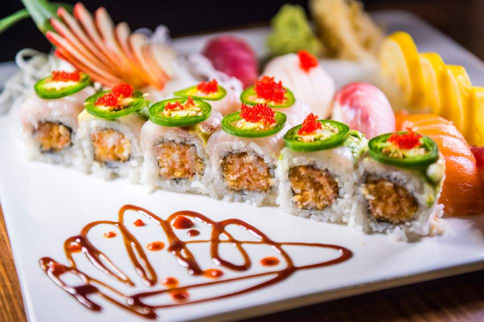 Chris Detrick  |  The Salt Lake Tribune The Mind Eraser roll with spicy crabmeat, yellowtail and jalapeño slices and jalapeño sauce ($13) at Mizu Japanese Cuisne in West Valley City. Also on the plate is tuna, salmon, striped bass and white tuna sashimi.