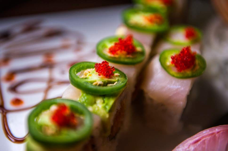 Chris Detrick  |  The Salt Lake Tribune The Mind Eraser roll with spicy crabmeat, yellowtail and jalapeño slices and jalapeño sauce ($13) at Mizu Japanese Cuisne in West Valley City.