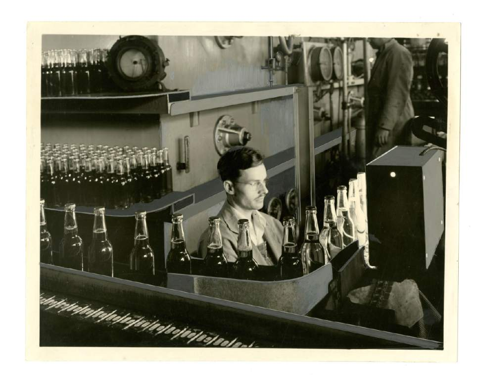 In this historical photo, an employee performs quality control at the Becker Brewing and Malting Factory, in Ogden. Courtesy  |  Utah State University Merril-Cazier Library, Special Collections and Archives Division
