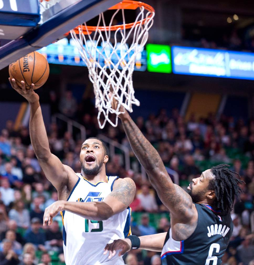 Lennie Mahler  |  The Salt Lake Tribune  Derrick Favors scores over DeAndre Jordan in the first half of a game between the Utah Jazz and the LA Clippers at Vivint Smart Home Arena, Monday, Feb. 13, 2017.