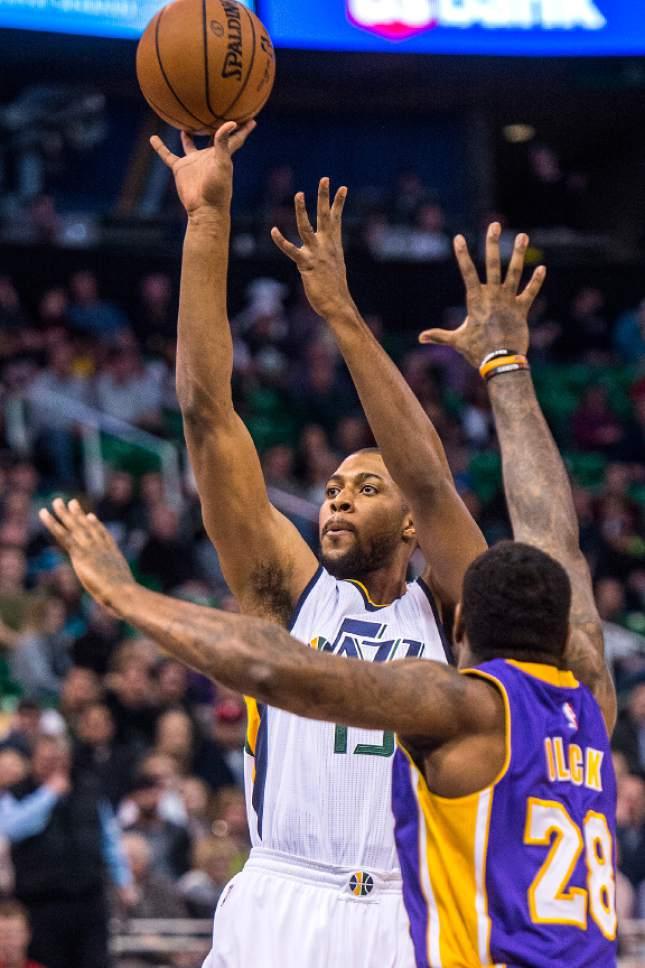 Chris Detrick  |  The Salt Lake Tribune Utah Jazz forward Derrick Favors (15) shoots over Los Angeles Lakers center Tarik Black (28) during the game at Vivint Smart Home Arena Thursday January 26, 2017.