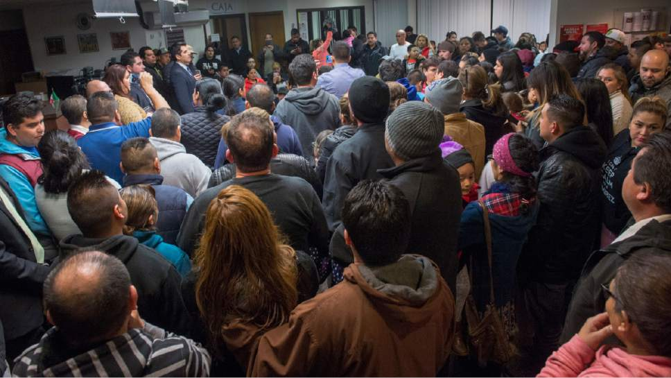 "Rick Egan  |  The Salt Lake Tribune  A standing room only crowd listens to  Mexican Consulate representatives and immigration lawyers, during a ""Know Your Rights"" information session at the Mexican Consulate, Wednesday, February 22, 2017."