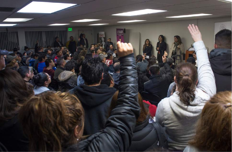 "Rick Egan  |  The Salt Lake Tribune  A standing room only crowd raise their hands to ask questions, as Mexican Consulate representatives and immigration lawyers, spoke during a ""Know Your Rights"" information session in the basement of the Mexican Consulate. The crowd was so large, it had do be split into two groups, Wednesday, February 22, 2017."