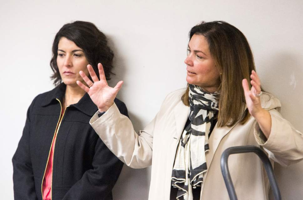"Rick Egan  |  The Salt Lake Tribune   Immigration attorney's Leonor Perretta and Barbara Melendez take questions from  a standing room only crowd during a ""Know Your Rights"" information session in the basement of the Mexican Consulate. The crowd was so large, it had do be split into two groups, Wednesday, February 22, 2017."