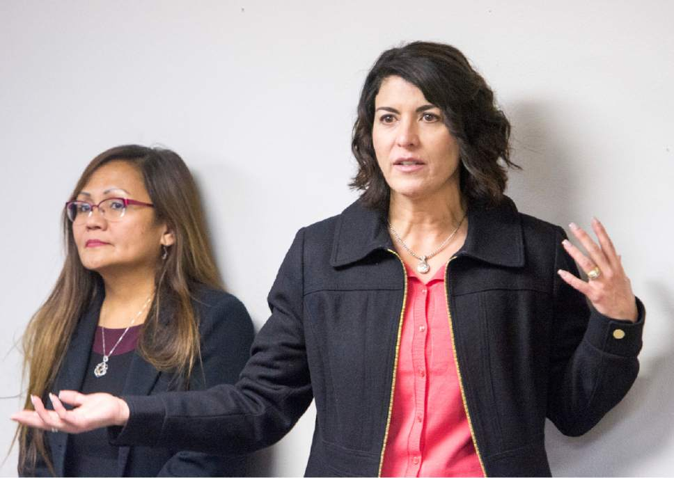 "Rick Egan  |  The Salt Lake Tribune  Marlene Gonzalez  listens as Immigration attorney, Leonor Perretta takes questions from  a standing room only crowd during a ""Know Your Rights"" information session in the basement of the Mexican Consulate. The crowd was so large, it had do be split into two groups, Wednesday, February 22, 2017."