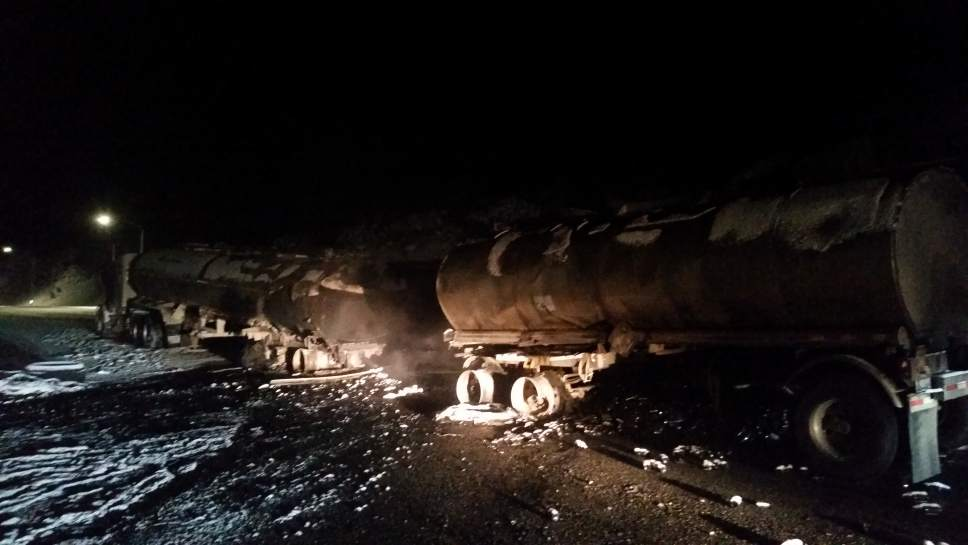 Courtesy | Utah Highway Patrol  A trucker was killed in a fiery crash between two semis, one hauling oil, late Wednesday night on I-80.
