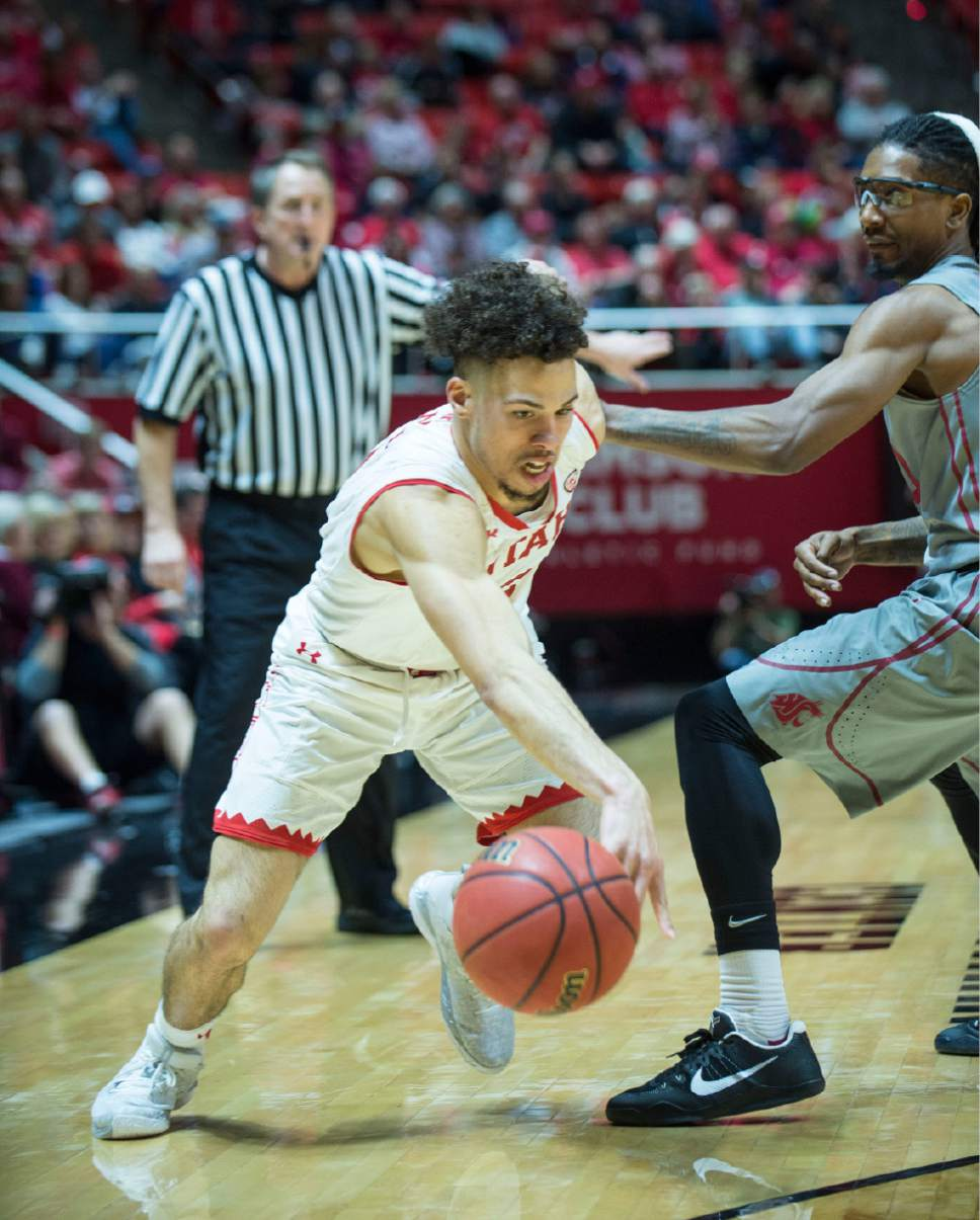 Lennie Mahler  |  The Salt Lake Tribune  Utah's Devon Daniels drives past Washington State's KJ Langston during a game between Utah and Washington State at the Huntsman Center in Salt Lake City, Thursday, Feb. 9, 2017.