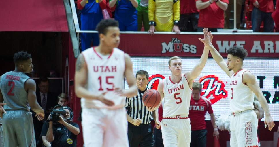 Lennie Mahler  |  The Salt Lake Tribune  Utah's Parker Van Dyke and Devon Daniels celebrate after Van Dyke pulled in a key rebound in the final seconds during a game between Utah and Washington State at the Huntsman Center in Salt Lake City, Thursday, Feb. 9, 2017.