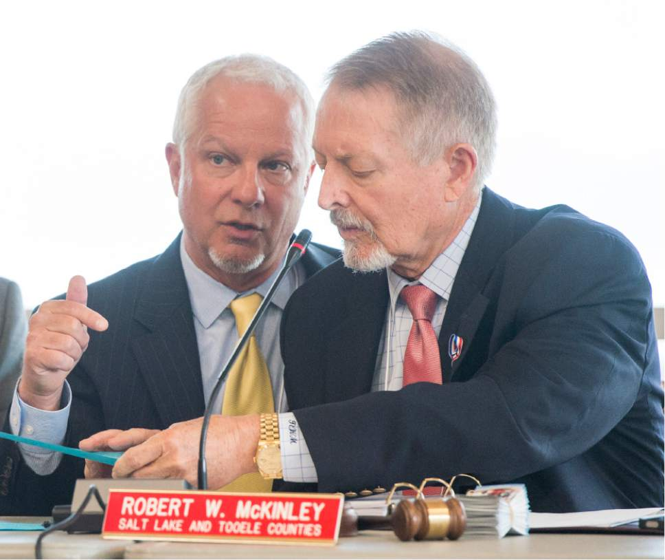 Rick Egan  |  Tribune file photo  UTA CEO Jerry Benson, left, chats with Board Chairman Robert W. McKinley at a Utah Transit Authority Board meeting earlier this year.