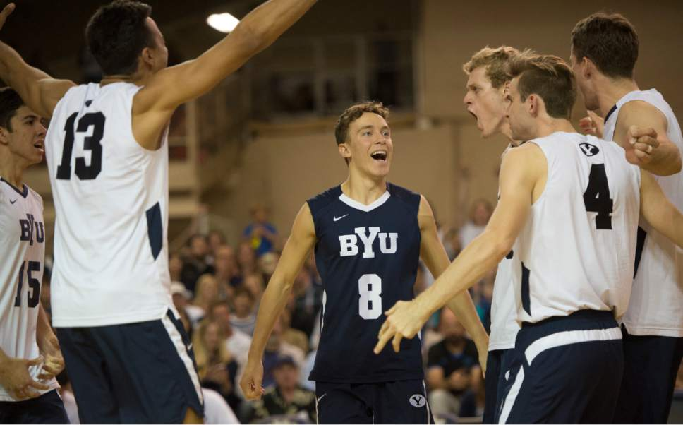 Rick Egan  |  The Salt Lake Tribune  Brigham Young Cougars Erik Sikes (8) celebrates a BYU score with his team mates, in the Mountain Pacific Sports Federation Volleyball Championship game, in tournament action at the Smith Field House in Provo, Saturday, April 23, 2016.