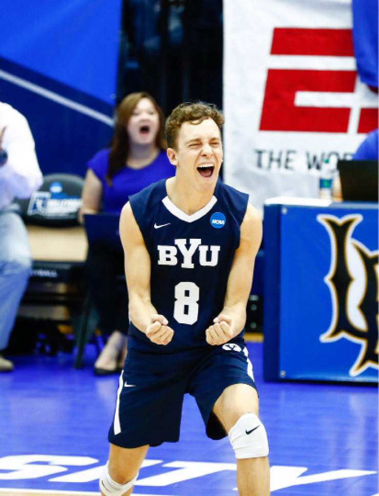 Sikes, Erik _W1_4012  BYU's Erik Sikes celebrates a point. The BYU men's volleyball was defeated by Ohio State 0-3 in the Championship Match of the NCAA Men's Volleyball Championships. The Championships were hosted at Rec Hall, on the Penn State campus in University Park, Pennsylvania.  April 7, 2016  Photo by Jaren Wilkey/BYU  © BYU PHOTO 2016 All Rights Reserved photo@byu.edu  (801)422-7322