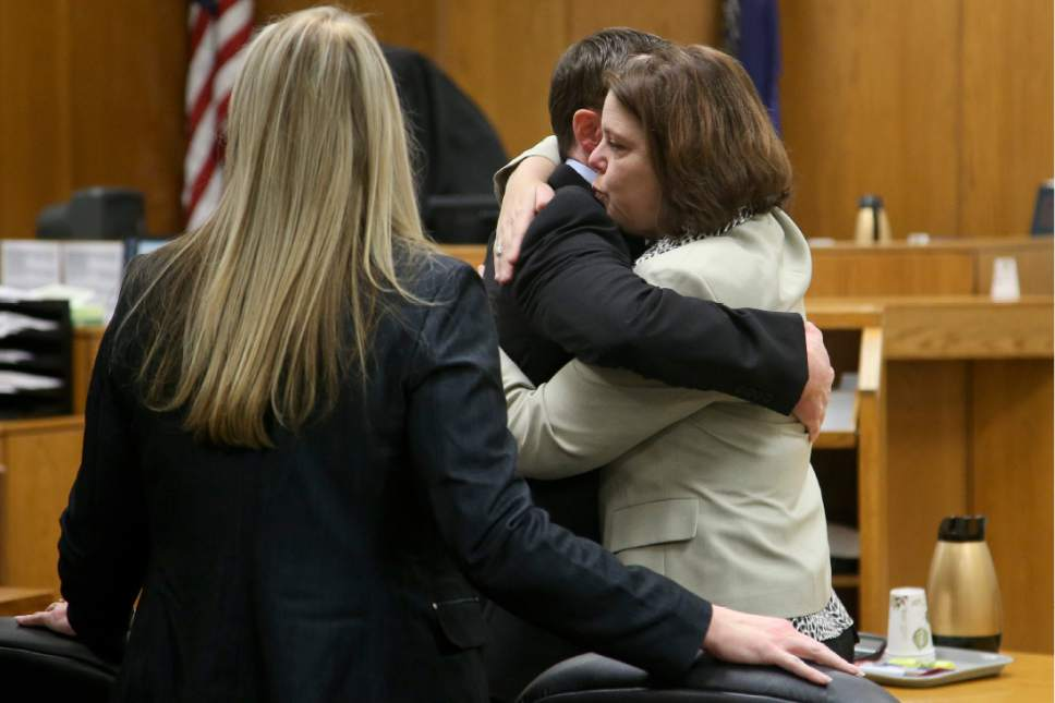 Conrad Truman hugs his attorneys after finding out that he is not guilty after his second murder trial Friday, Feb. 24, 2017 in Provo. DOMINIC VALENTE, Daily Herald
