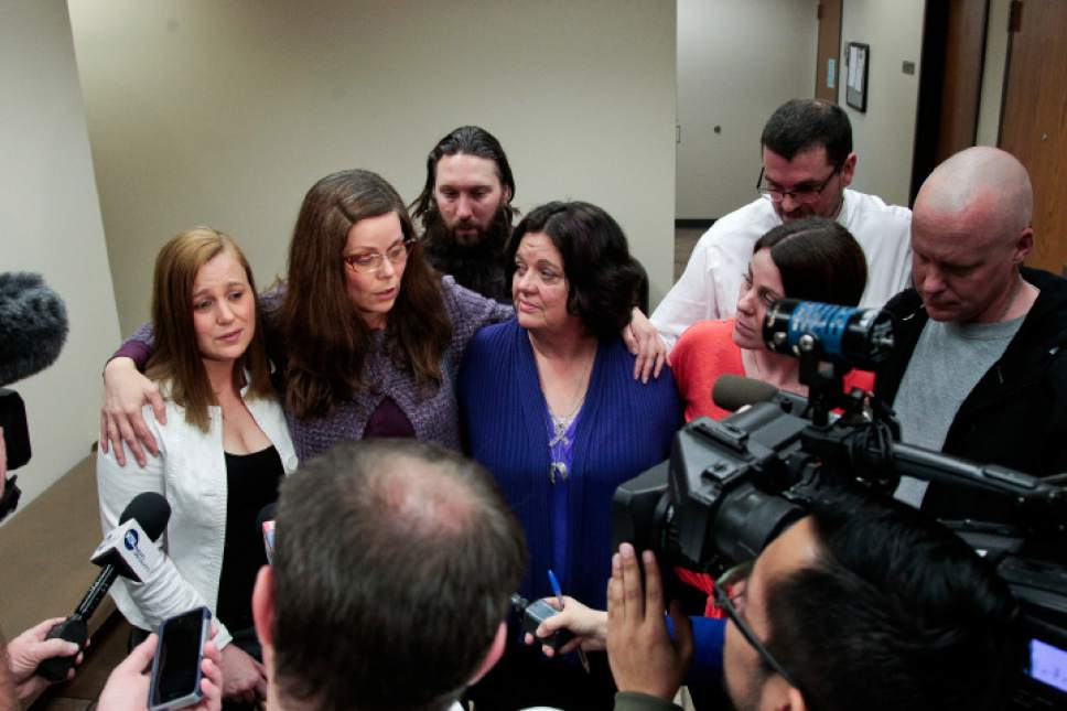 Spenser Heaps  |  File photo Family members of Heidy Truman, including her mother Janet Wagner, center, and sisters Amanda Wagner, Autumn Wagner and Sommer Keller, speak to the media following the sentencing of Conrad Truman at 4th District Court in Provo in Feb. Truman was sentenced to consecutive sentences of 15 years to life for murder and one to 15 years for obstruction of justice in the 2012 shooting death of his wife Heidy Truman.