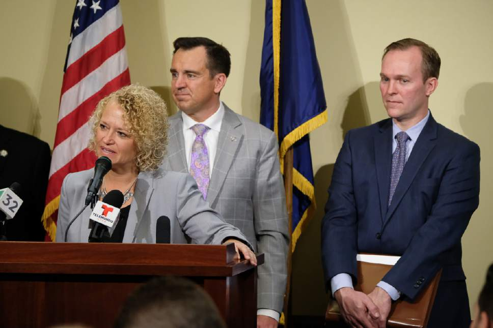 Francisco Kjolseth | The Salt Lake Tribune Salt Lake City Mayor Jackie Biskupski is joined by other Utah leaders in announcing that the city is dropping two of four planned homeless resource centers during a press announcement at the Utah Capitol on Friday, February 24, 2017. To her right are speaker of the house Greg Hughes, R-Draper, and Salt Lake County Mayor Ben McAdams.
