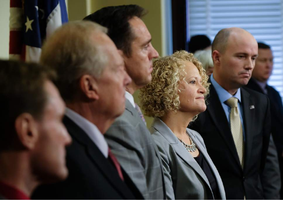 Francisco Kjolseth | The Salt Lake Tribune Salt Lake City Mayor Jackie Biskupski, second from right, is joined by other Utah leaders in announcing that the city is dropping two of four planned homeless resource centers during a press announcement at the Utah Capitol on Friday, February 24, 2017.